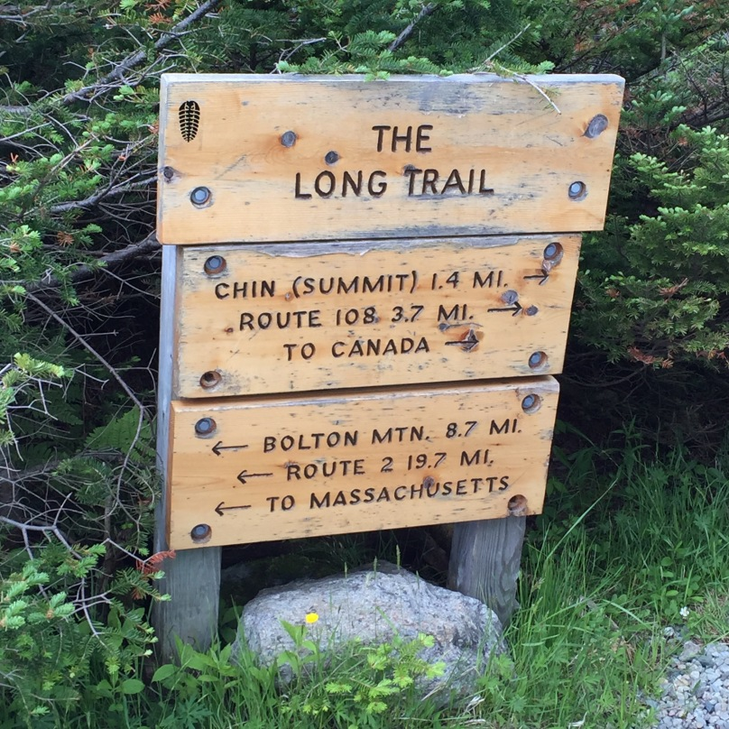 Trail head sign from the toll road